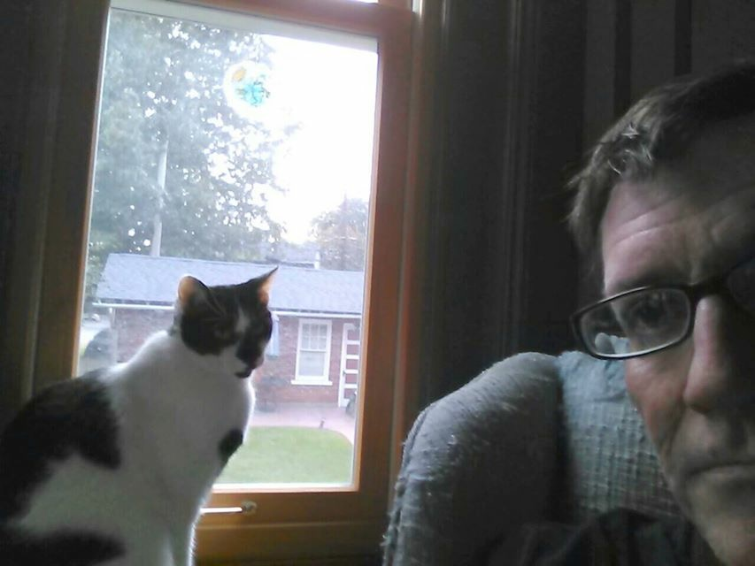 Social Studies teacher Tom Warnke and one of his beloved cats