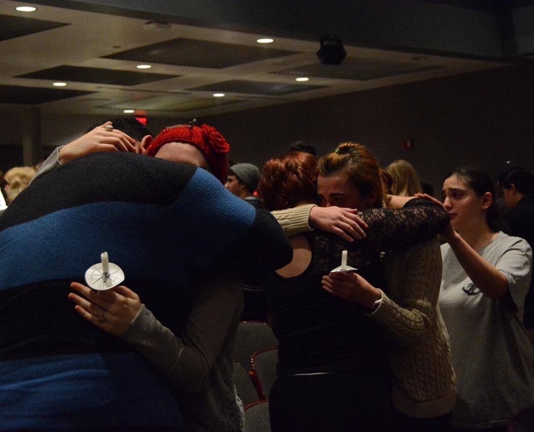 Former EHS students embrace one another as the emotional night comes to a close.