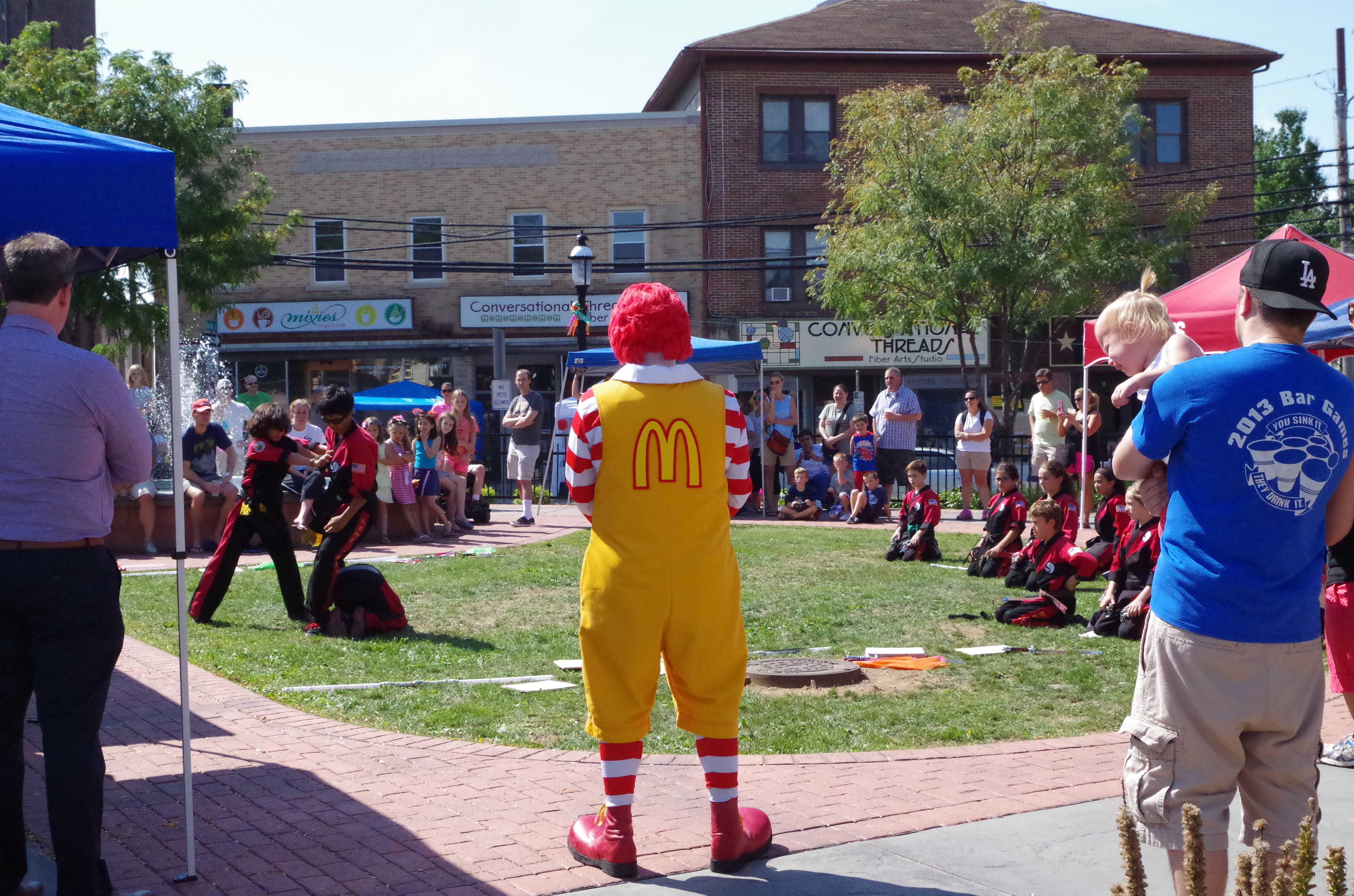 Ronald McDonald watches the martial arts performers. Photo by Cathryn Seibert