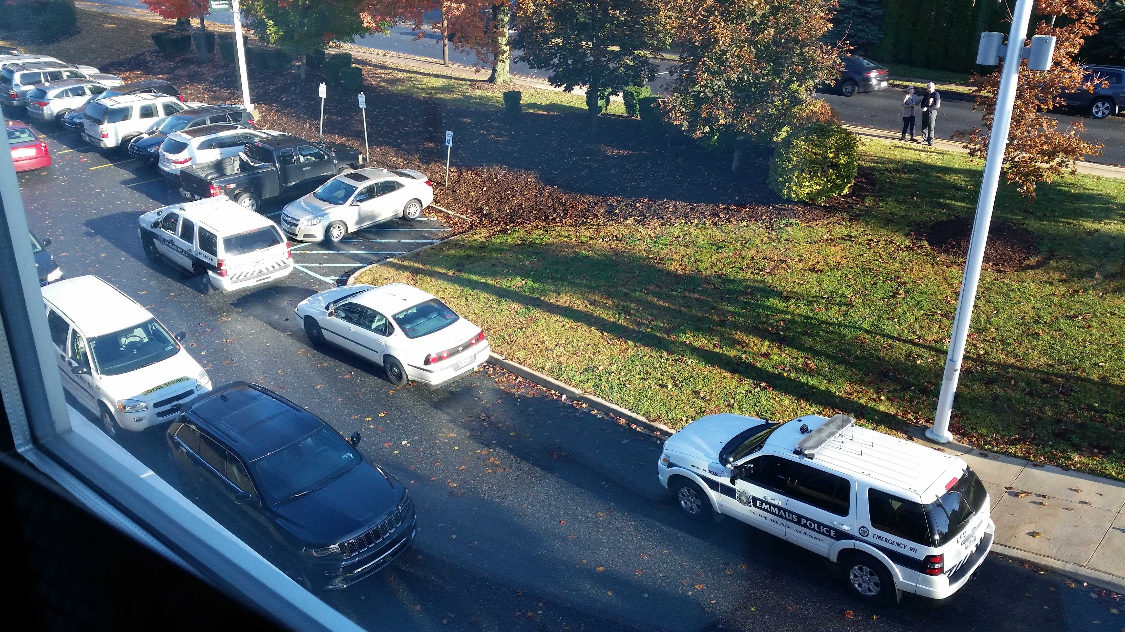 Police cars crowd the Macungie Avenue parking lot outside of the main office