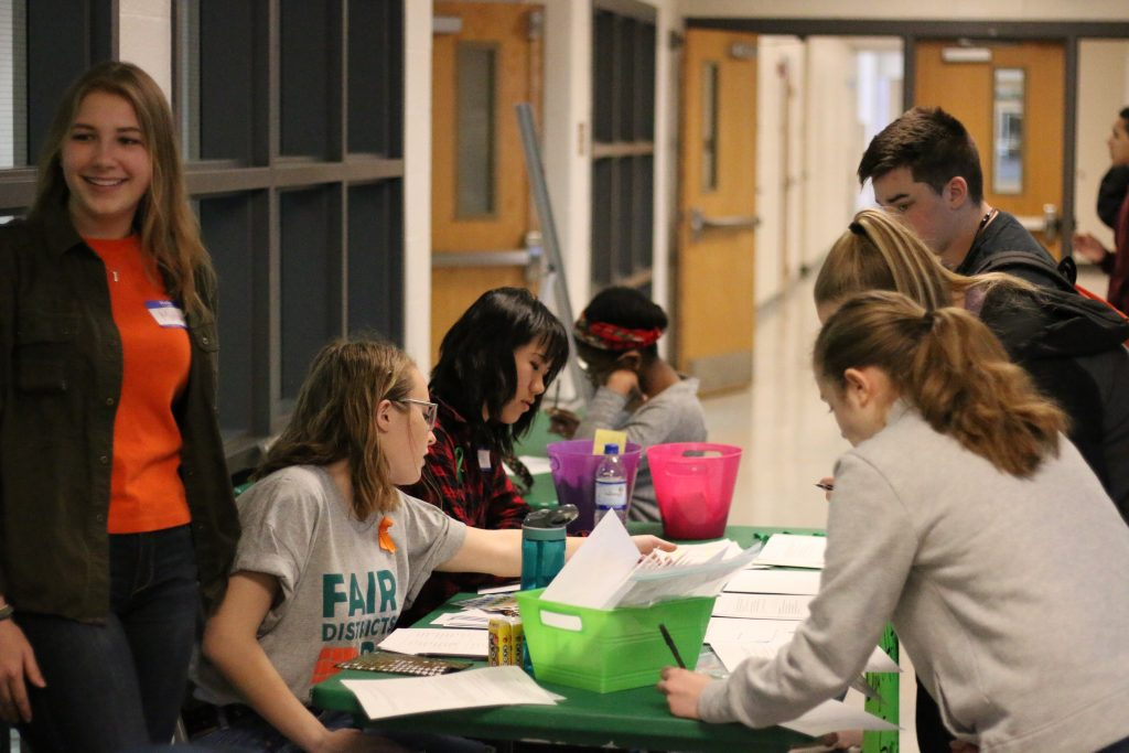 Students write letters to politicians outside of the EHS cafeteria. Photo by Rylan Bassett.