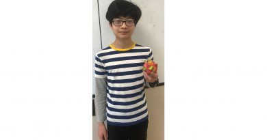 Inaoka holds an origami. Photo by The Stinger.