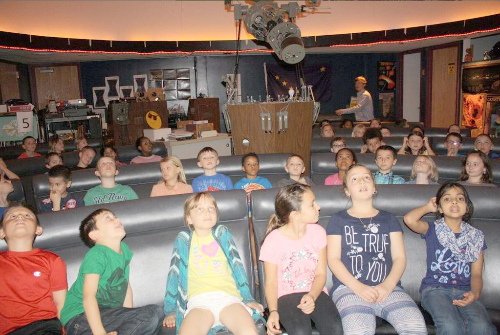 Elementary schoolers learning about space on a field trip to the EHS planetarium.