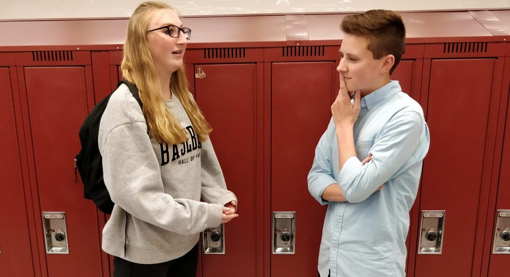 Senior Erin Lavelle gives advice to an underclassmen in the locker commons.