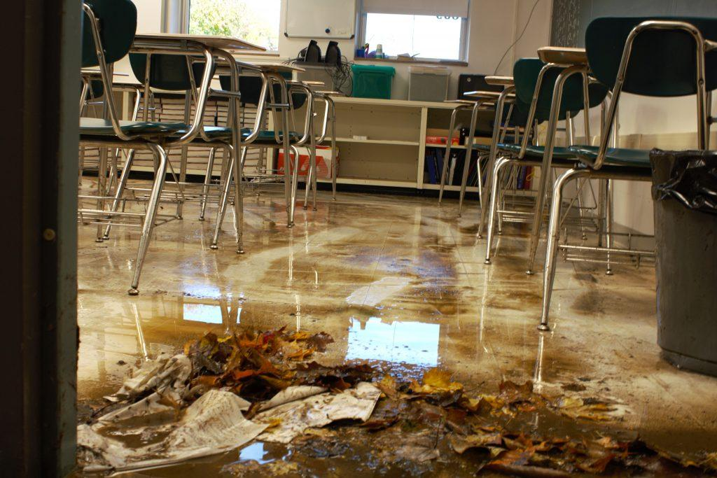 Lower level classrooms filled with dirt and debris after a freak storm caused a flood at EHS. Photo by Rylan Bassett.