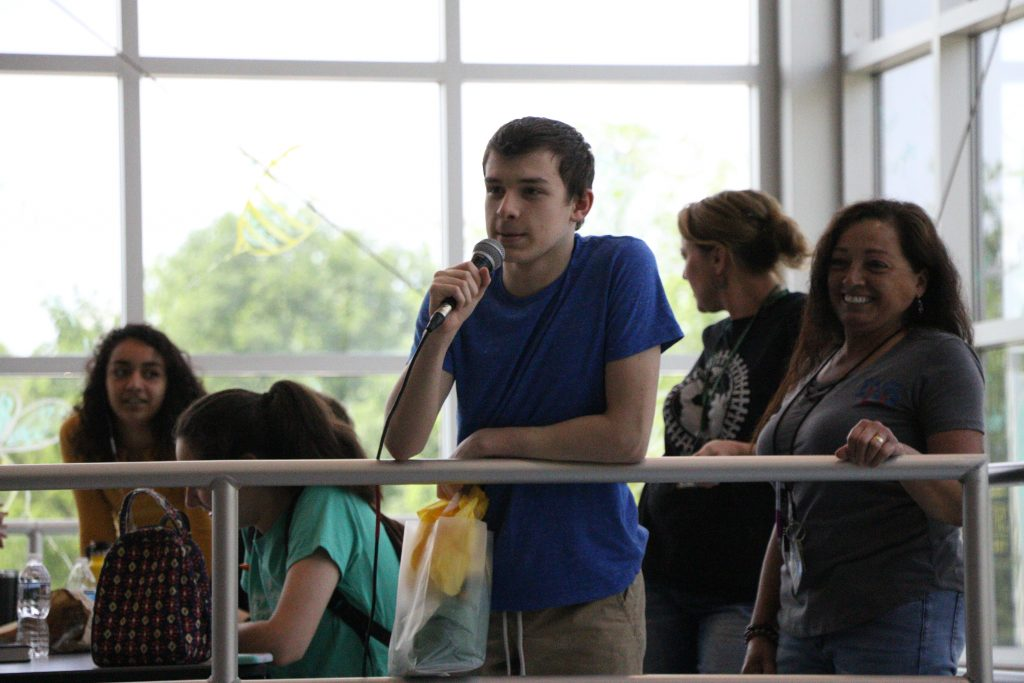 Freshman Ben Ruschman addresses the cafeteria after accepting his gift. Photo by Rylan Bassett.