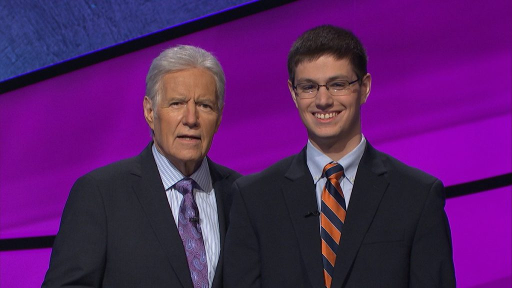 Bilger and Trebek pose together at the