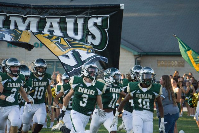The Emmaus Green Hornet Football Team enters the field for their first home game on August 30. Photo by Alice Adams.