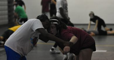 Female student shines on wrestling team