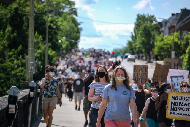 "Protesters march from Bethlehem Rose Garden Park to the Bethlehem Public Library with signs in hand and masks in place, chanting ""No justice, no peace,"" ""Say his name-- George Floyd,"" and ""Black Lives Matter"" along the way. Photo by Meliha Anthony."