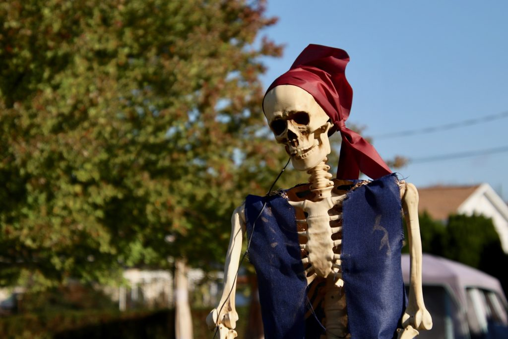 A pirate skeleton stands among many other festive monsters in front of an Emmaus home. Photo by Bethany Brown.