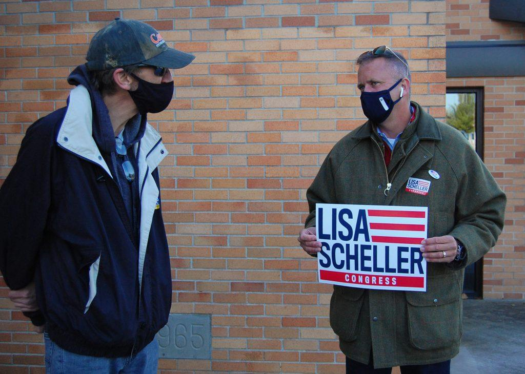 "Miller talks to Howard Schaeffer, another volunteer at the polls. ""Our country is at a crossroads right now, and I don't think we should lose our American way,"" Schaeffer said. Photo by Meliha Anthony."