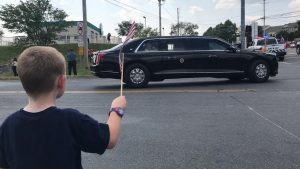 Jonathan Shreck, who will be a kindergartner this year at Macungie Elementary School, waves a flag at President Joe Biden after the president's tour of Mack Trucks on July 28. Photo courtesy of Jeff Shreck.
